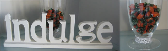 Indulge corporate table sign for candy bar hire